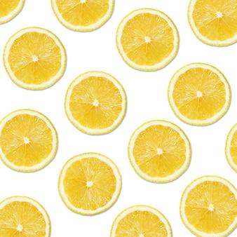 Yellow lemon slices on white background closeup studio photography