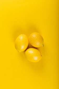 Yellow lemons isolated . top view