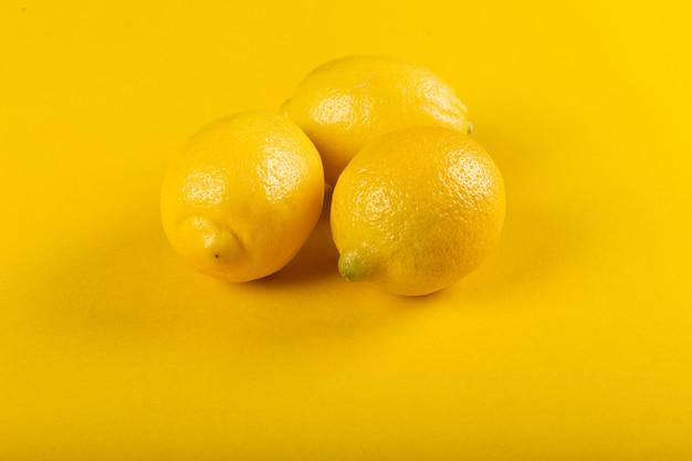 Yellow lemons isolated .