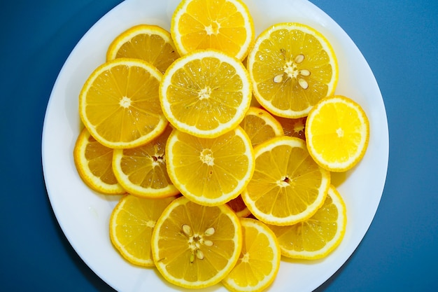 Yellow lemons on a plate on a sunny day
