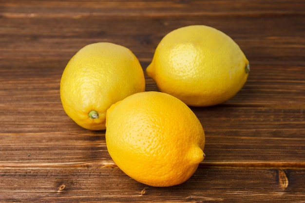 Yellow lemons on a wooden surface. high angle view. copy space for text