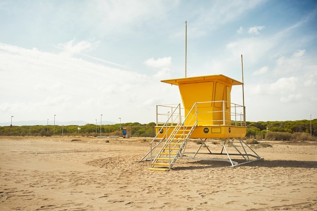 Yellow lifeguard post onn empty beach