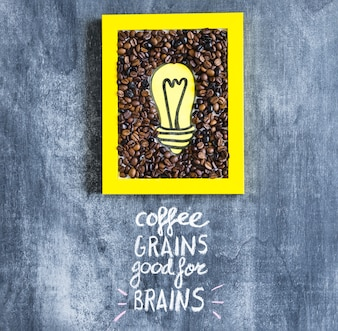 Yellow light bulb and coffee beans frame with text on chalkboard