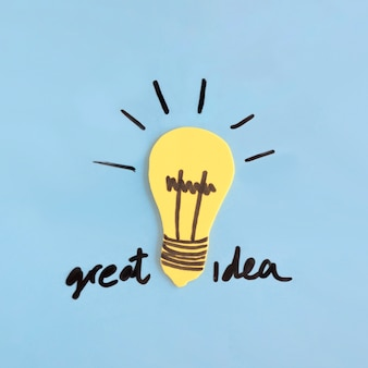 Yellow light bulb with great idea text on blue background