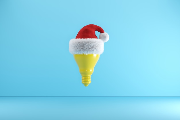 Yellow light bulb with santa hat floating on blue