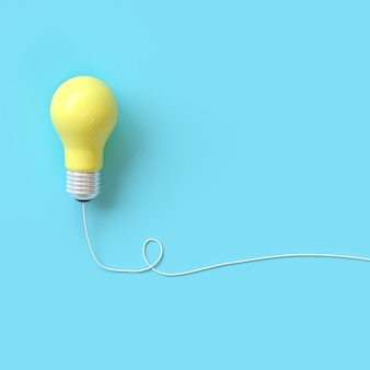 Yellow lightbulb with wire on blue background for copyspace.