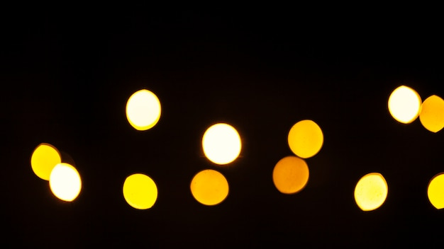 Yellow lights on black background