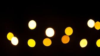 Yellow lights on black background