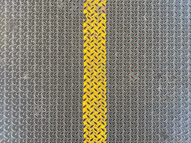 Yellow line metal plate wall background.