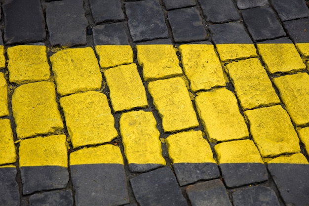 Yellow line sign on the pavement