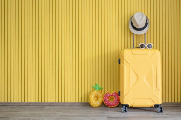 Yellow luggage and with traveler equipment