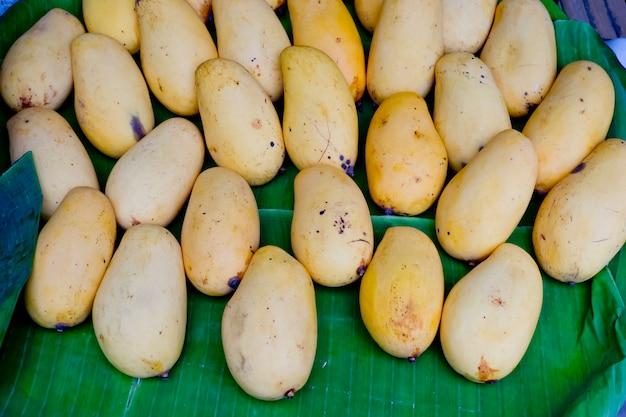 Yellow mango on banana leaf at thai market