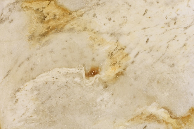 Yellow marble stone texture background.