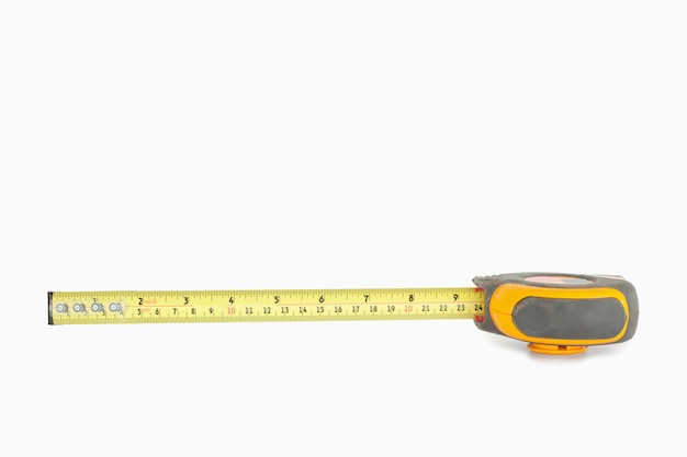 Yellow measuring tape partly unrolled