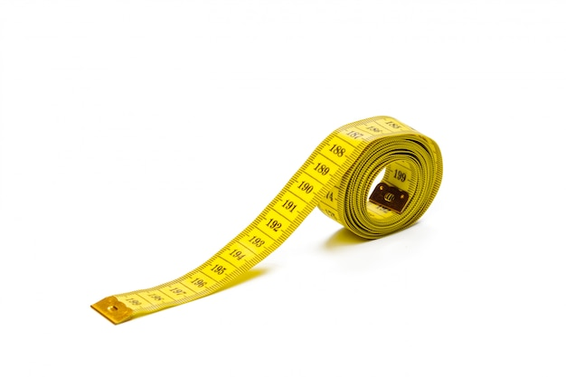 Yellow metric measuring tape isolated on white panorama