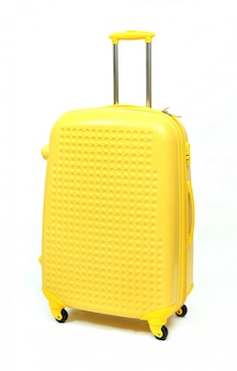 Yellow of modern large suitcase on a white