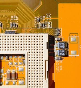 Yellow motherboard with empty socket
