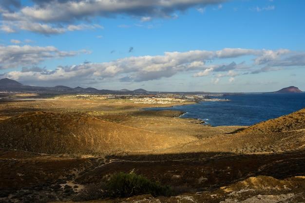 The yellow mountain on the ocean shore in costa del silencio, tenerife, the canaries