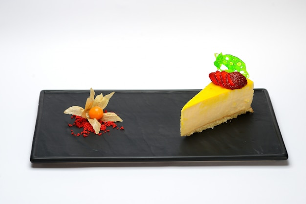 Yellow mousse dessert with strawberries