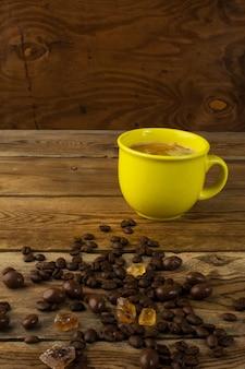Yellow mug of strong coffee and brown sugar