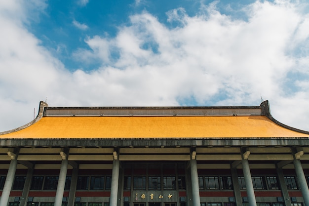 The yellow of national dr. sun yat-sen memorial hall with blue sky and cloud in taipei, taiwan.