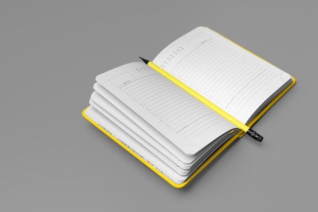 Yellow notepad with yellow pencil on gray background