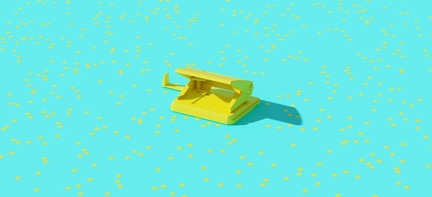 Yellow office paper punch with confetti on blue background