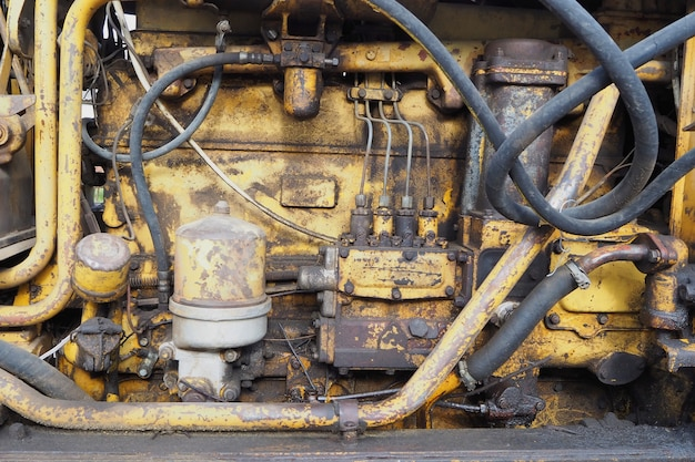 Yellow old tractor engine motor close up