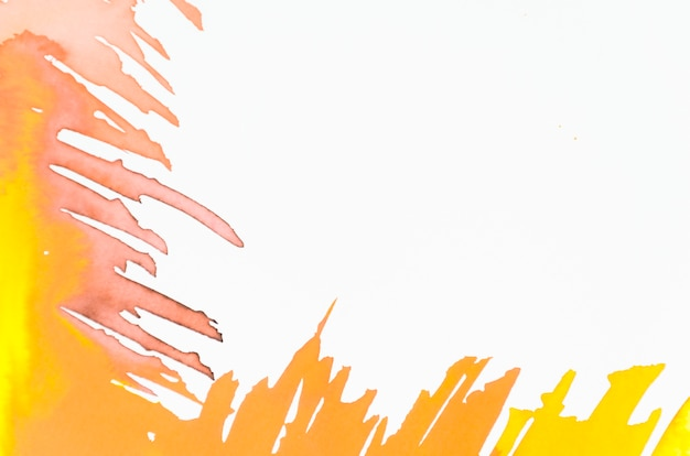 Yellow and orange brush stroke on white backdrop