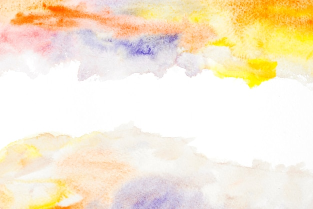 Yellow and orange watercolor stain on white background