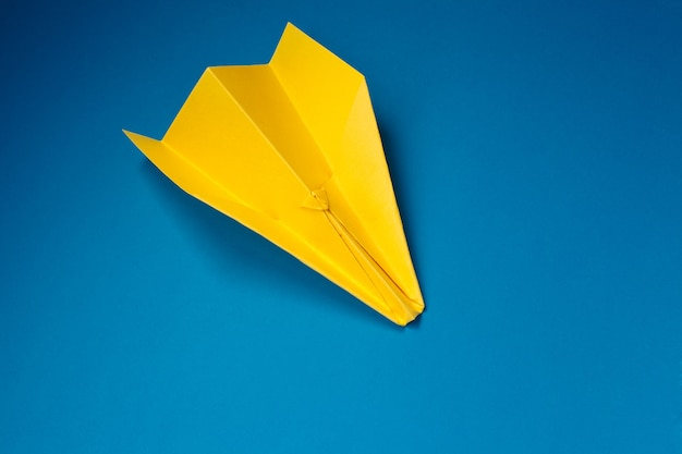 Yellow origami plane