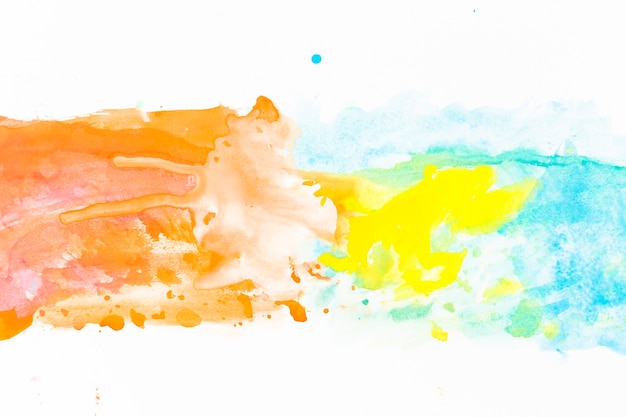 Yellow paint on orange and turquoise
