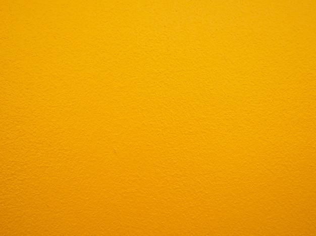 黄色の塗料壁の背景