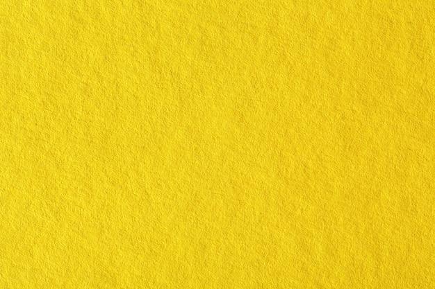 黄色い紙の背景。テクスチャの高解像度写真。
