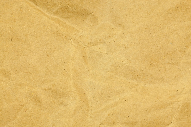 Yellow paper crumpled texture background.