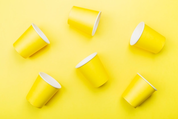 Yellow paper cups on yellow