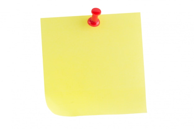 Yellow paper note stick with red thumbtack isolated on white