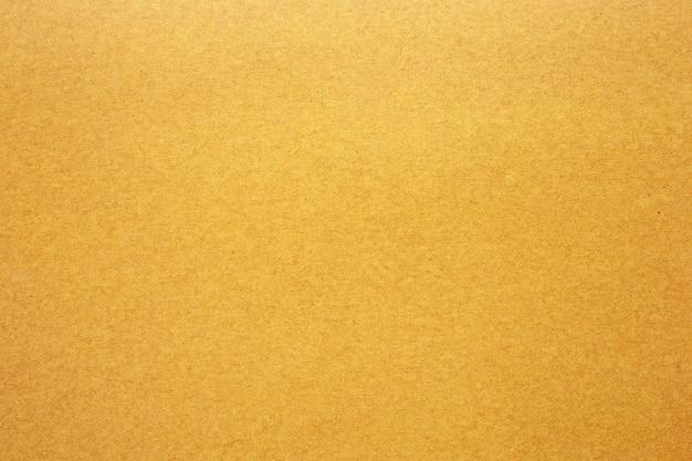 Желтая текстура бумаги или картона для поверхности