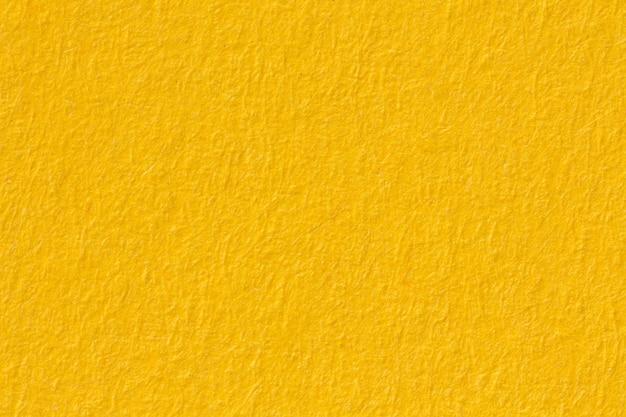 Текстура желтой бумаги, макросъемка. фото в высоком разрешении