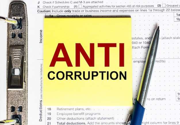 Yellow paper with text anti corruption.