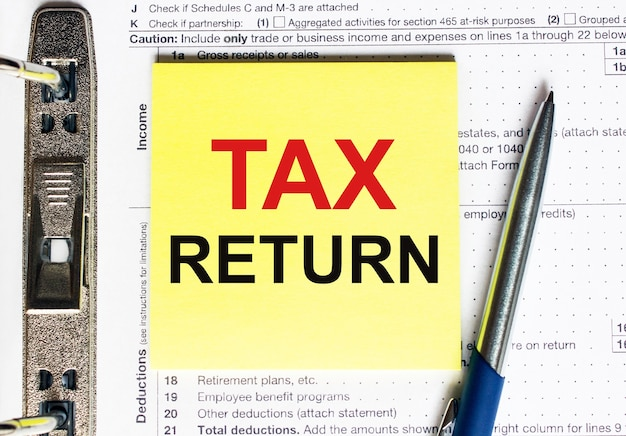 Yellow paper with text tax return,concept