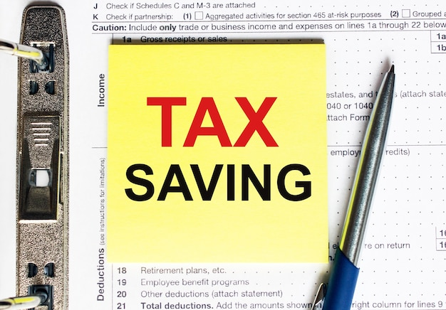 Yellow paper with text tax saving. financial concept