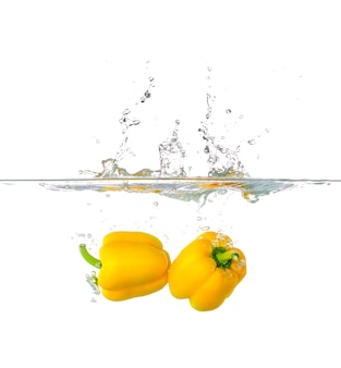 Yellow paprika splash in water