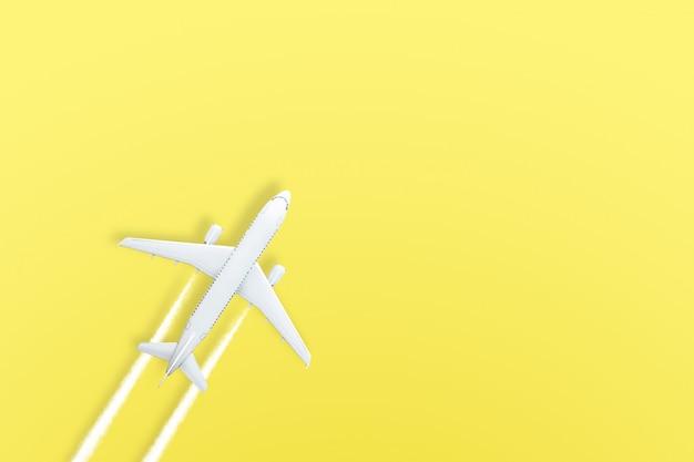 Yellow pastel paper airplane on yellow Premium Photo