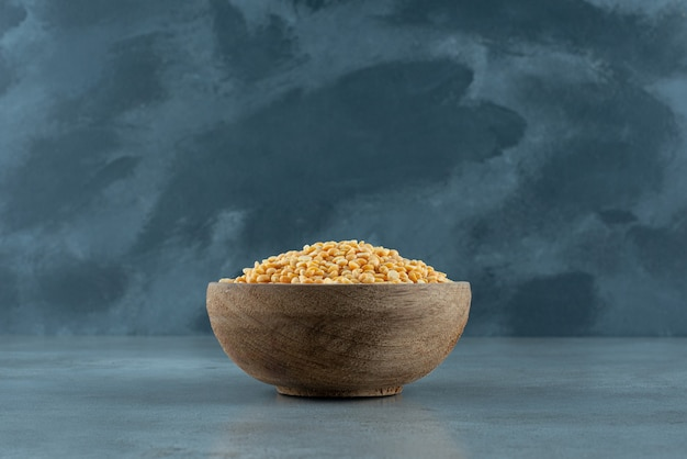 Yellow pea beans in a bowl on blue background. high quality photo