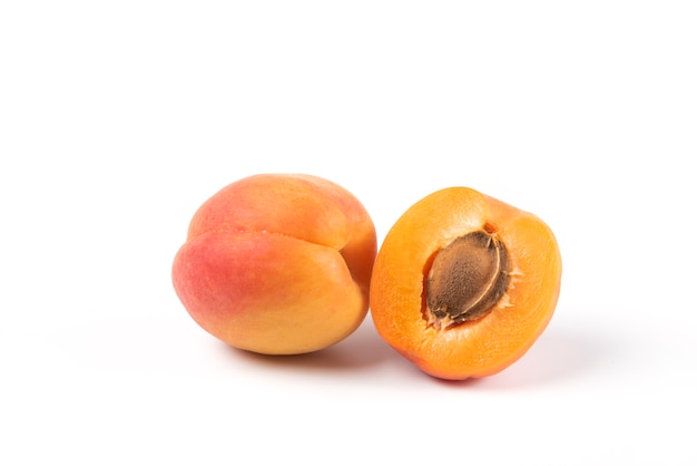 Yellow peaches isolated on white