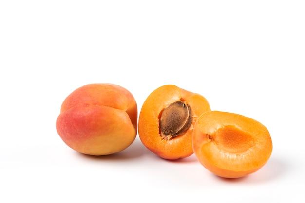 Yellow peaches isolated on white