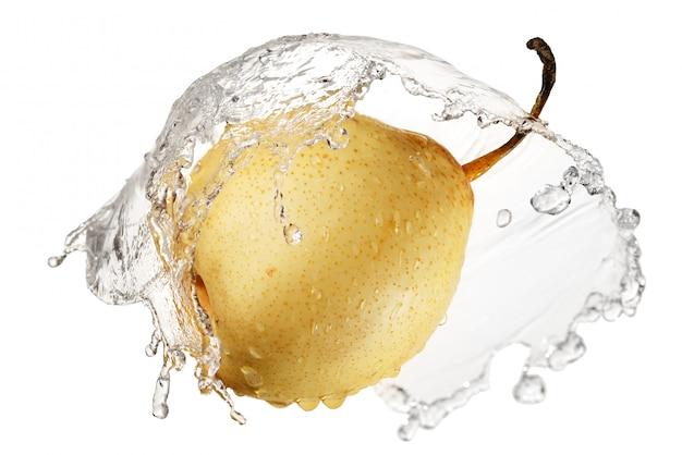 Yellow pear in splash of water