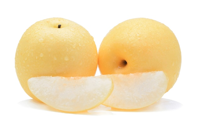 Yellow pear with water drops on white background