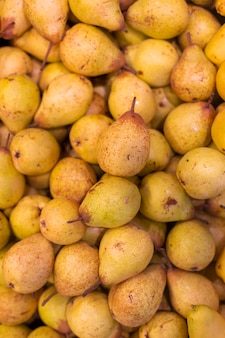 Yellow pears at the market stock